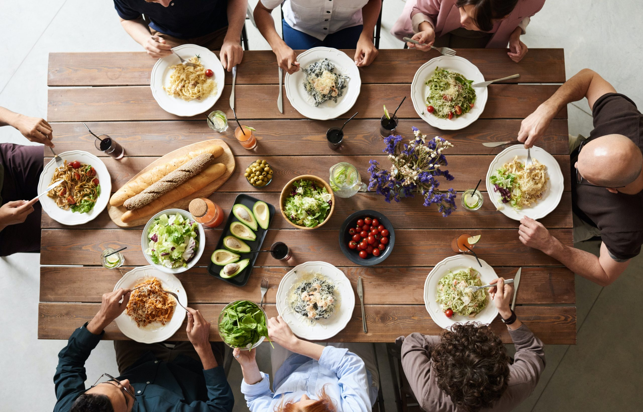 group-of-people-eating-together–scaled