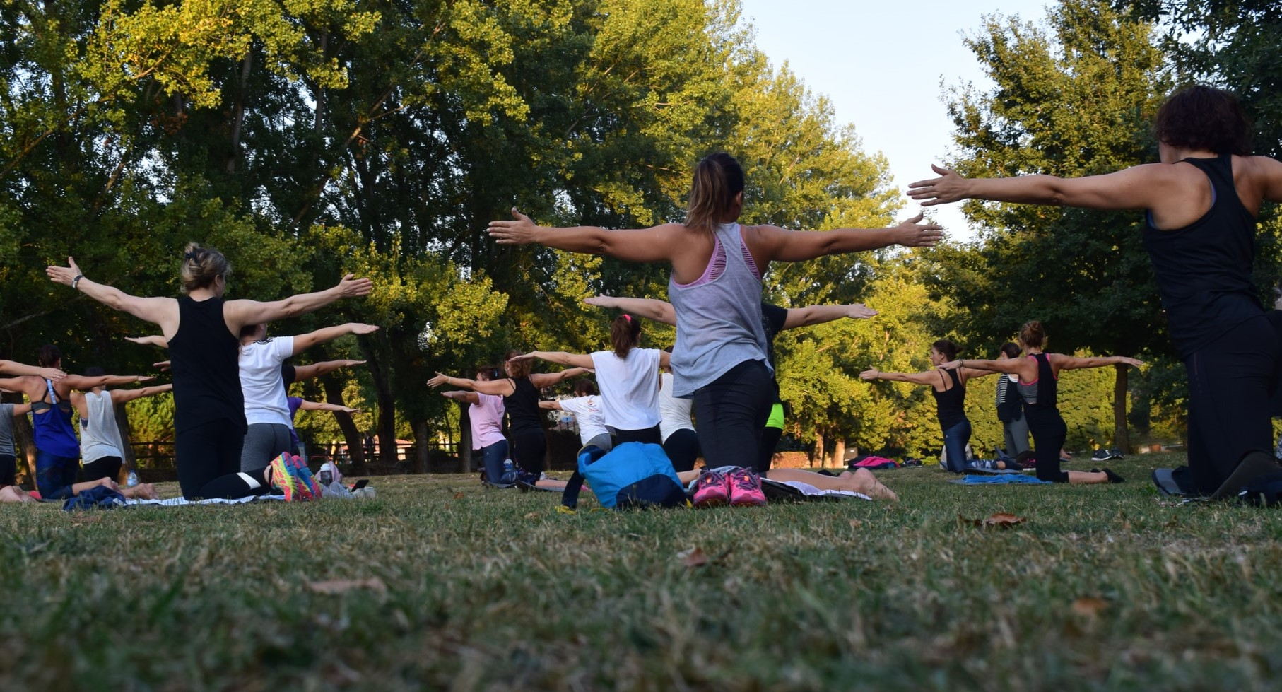 women-performing-yoga-on-green-grass-near-trees-1472887 (1)